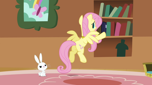 File:Fluttershy putting the books back into the bookshelf S3E10.png