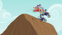 Motocrossers on top of a mound EG3
