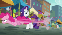 Pinkie Pie speeding past Rarity S6E3
