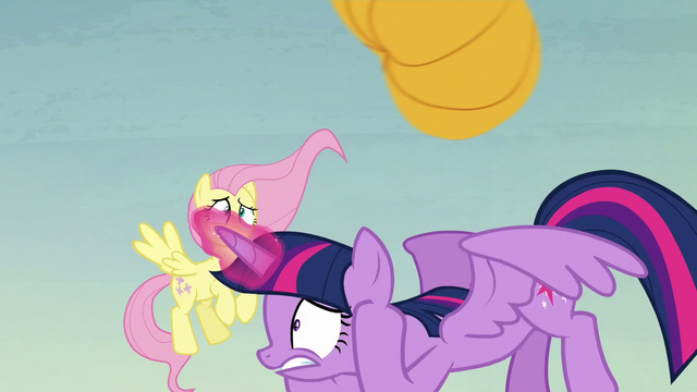 File:Twilight ducking under a flying pumpkin S5E23.png