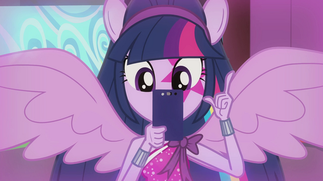 File:Twilight taking a picture with her phone EG2.png