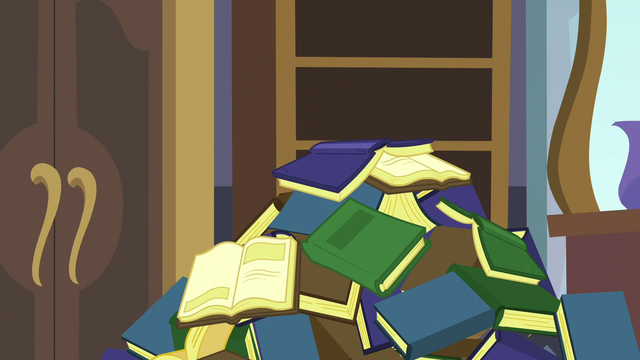 File:Pile of books falls on top of Spike S5E10.png