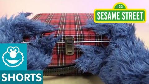 Sesame Street Cookie Monster Unboxes a Lunchbox