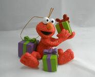 CarltonCardsHeirloom-2013-SesameStreet-ElmoHoldingPresents-ChristmasOrnament