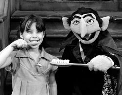 The Count brushing teeth