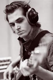 Mikey way wearing headphones