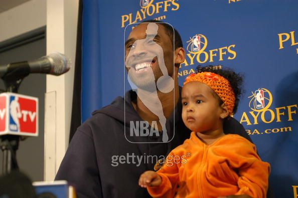 File:Kobe Bryant laughs with his daughter Natalia while talking to the press.jpg