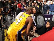 Kobe Bryant kisses his wife Vanessa Bryant following a Lakers win at Staples Center-1-