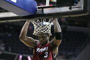 Dwyane Wade hanging on the rim