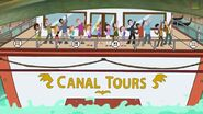Audience on a boat labeled 'Canal Tours'