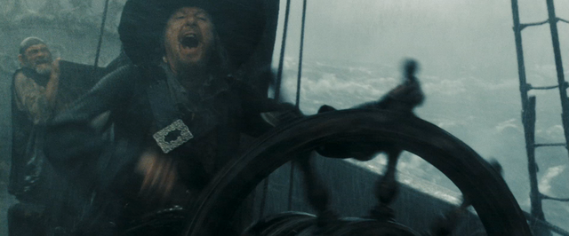 File:Barbossa at the wheel.png