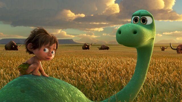 File:The Good Dinosaur Arlo and Spot Buffalo Field.jpg