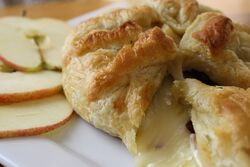 Crop baked brie with apple cranberry compote