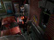 Resident Evil 3 Nemesis screenshot - Uptown - Street along apartment building - Jill Valentine gameplay 02