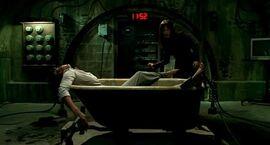 Saw v bathtub trap
