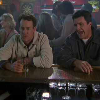 Janitor and Cox talk at the bar