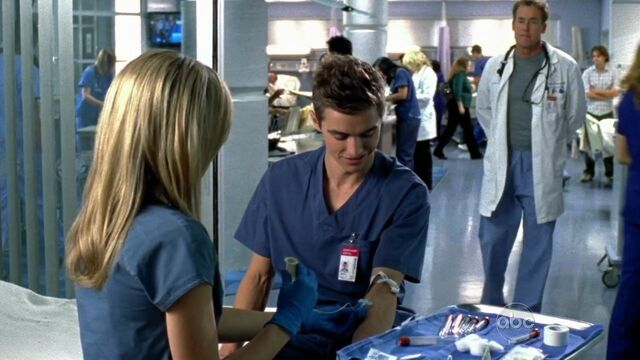 File:9x5 Lucy taking blood sample from Cole.jpg