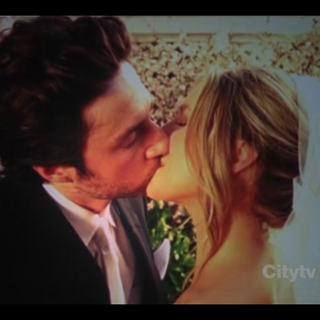J.D. and Elliot kissing on their wedding day.