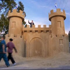 Janitor builds a giant sandcastle. <span style=