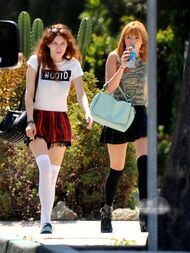 Bella-thorne-out-with-red-haired-curly-pal