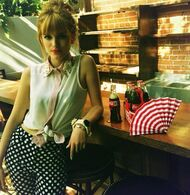 Bella-thorne-hairbun-white-top-at-table