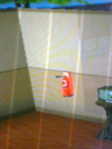 File:Fire extinguisher at the wall.png