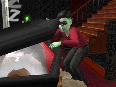 File:Alien looking in vampire coffin.jpg