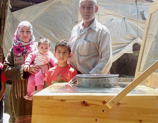 File:Gaza-solar-cookers-family June 2016.jpg