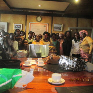 Mama solar poses for a photo with participants (Alliance of women in coffee) after training at coffee plaza office in Naiobi