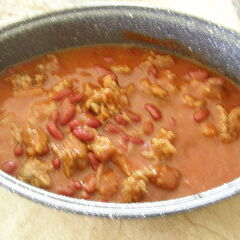 Add spices, beans and tomatoe sauce and cook for an additional 1 1/2 hours