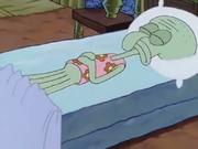 Squidward asleep, wearing floral PJs