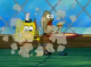 Spongebob dusting in front of Fred