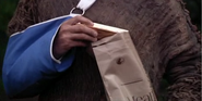 Keras holding Chocolate bar