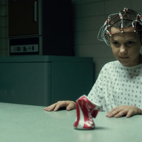 Eleven crushing the can.