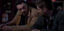 Dean and Lawless in a bar