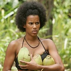 Erica gathering coconuts.