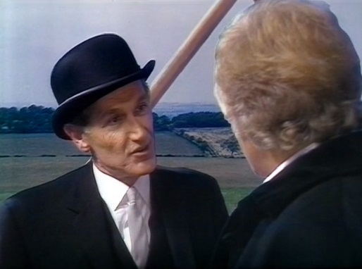 File:Time Lord Messenger Warns Doctor of Master's Presence.jpg