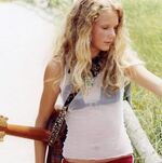 Young Taylor with guitar