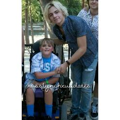 Ross Lynch with a fan