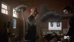 Teen Wolf Season 5 Episode 3 Dreamcatcher Deaton throws mountain ash.png