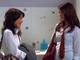 Mara and Patricia talking in bathroom
