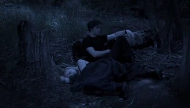 File:Maysilee with Haymitch sleeping.jpg
