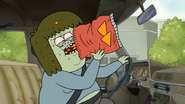 S4E34.005 Muscle Man Shoving a Bag of Chips in His Mouth