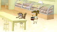 S6E06.088 Rigby Sitting at a Table