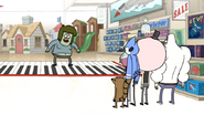 S6E05.055 Muscle Man on a Giant Toy Piano Mat