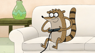 S5E01.015 Rigby Happily Playing Video Games