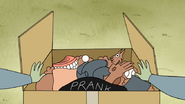 S3E35.199 Muscle Man Opening His Prank Box