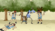 S4E13.155 Mordecai and Rigby Blocking Two Scythe Guards