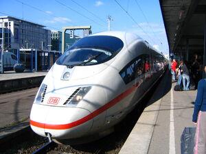 Sleek white passenger train at a station