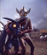 Memole v Ultraman Taro